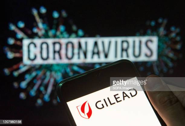 In this photo illustration the American biotechnology company Gilead Sciences logo seen displayed on a smartphone with a computer model of the...