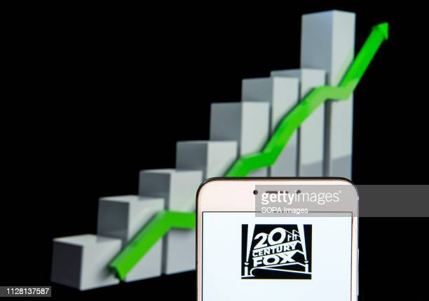 American film studio Twentieth 20th Century Fox Film Corporation logo is seen on an android mobile device with an ascent growth chart in the...