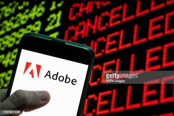 In this photo illustration the American multinational computer multimedia and creativity software company Adobe logo is seen on an Android mobile...