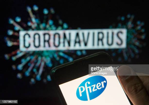 In this photo illustration the American multinational pharmaceutical corporation Pfizer logo seen displayed on a smartphone with a computer model of...