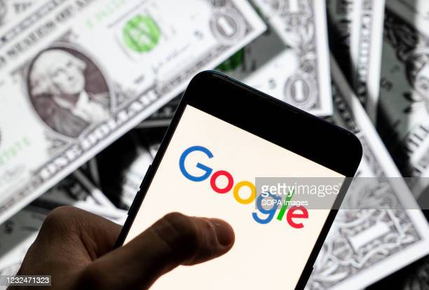 In this photo illustration the American multinational technology company and search engine Google logo seen on an Android mobile device screen with...