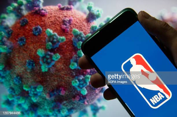 In this photo illustration the American National Basketball Association men's professional basketball league logo seen displayed on a smartphone with...