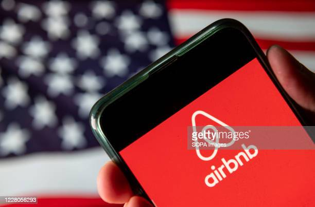 In this photo illustration the American online marketplace and hospitality service Airbnb logo is seen on an Android mobile device with United States...