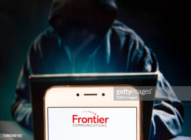 In this photo illustration the American telecommunications company Frontier Communications Corporation logo is seen displayed on an Android mobile...