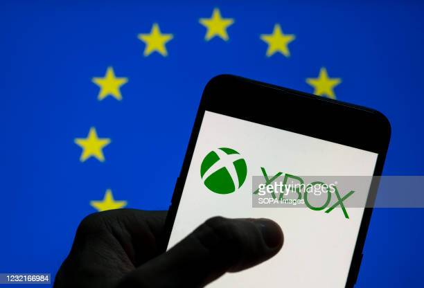 In this photo illustration the American video gaming brand created and owned by Microsoft, Xbox, logo is seen on an Android mobile device screen with...