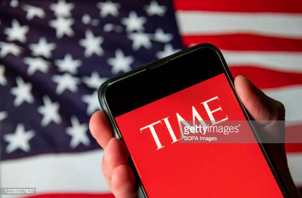 In this photo illustration the American weekly news magazine and news website Time logo is seen on an Android mobile device with United States of...