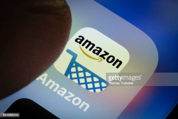 In this photo illustration the app of American electronic commerce and cloud computing company amazon is displayed on a smartphone on March 20 2018...