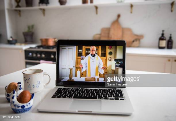 In this photo illustration the Archbishop of Canterbury, Justin Welby, gives the first national digital Easter Sunday service from his kitchen at...