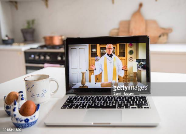 In this photo illustration the Archbishop of Canterbury Justin Welby gives the first national digital Easter Sunday service from his kitchen at...