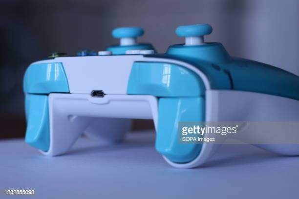 In this photo illustration, the back view of a a generic controller for Microsoft Xbox 360 game system displayed on a table.
