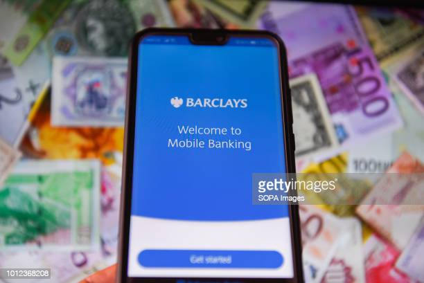In this photo illustration the Barclays bank logo is seen displayed on a mobile phone