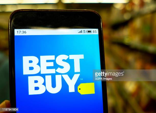 In this photo illustration the Best Buy logo is seen displayed on a smartphone