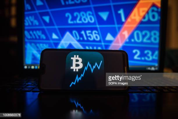 Bitcoin logo is seen on a mobile phone