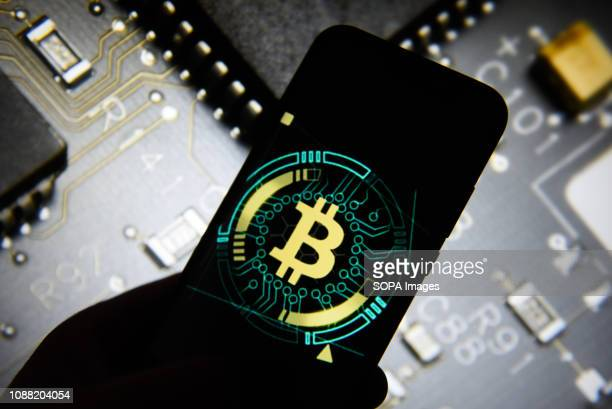 In this photo illustration the Bitcoin logo is seen displayed on an Android mobile phone