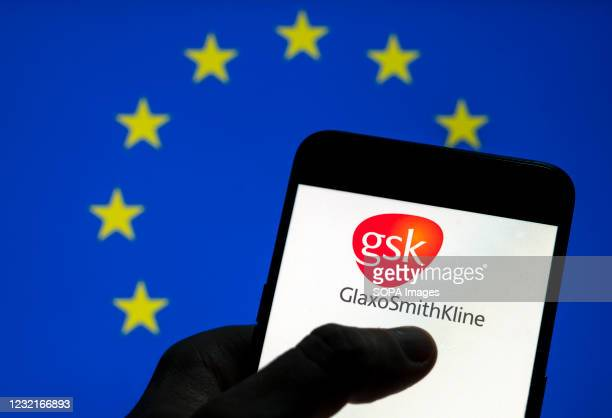 In this photo illustration the British multinational pharmaceutical company GlaxoSmithKline logo is seen on an Android mobile device screen with the...