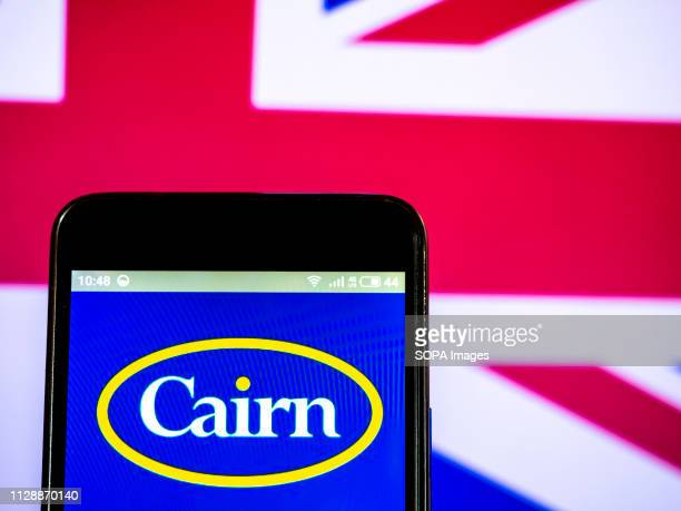 In this photo illustration, the Cairn Energy PLC company logo seen displayed on a smartphone.