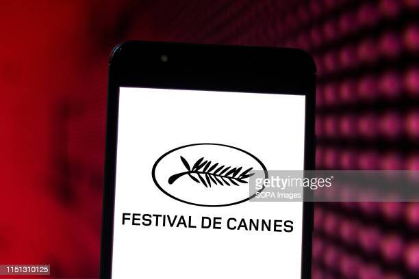 In this photo illustration the Cannes Festival logo is seen displayed on a smartphone.
