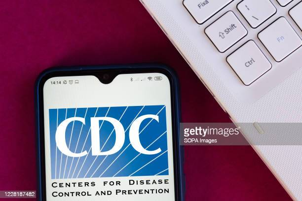 In this photo illustration the Centers for Disease Control and Prevention logo seen displayed on a smartphone.