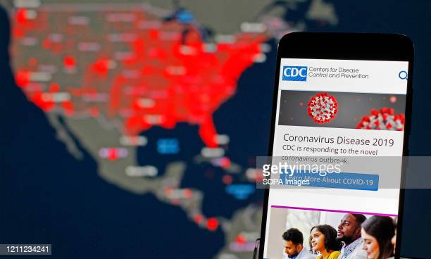 In this photo illustration the Centers of Disease Control and Prevention web page is seen displayed on a mobile phone. The number of the COVID-19...