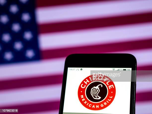 In this photo illustration the Chipotle Mexican Grill Restaurant company logo seen displayed on a smartphone
