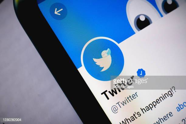 In this photo illustration the close-up of the Twitter website seen displayed on a smartphone.