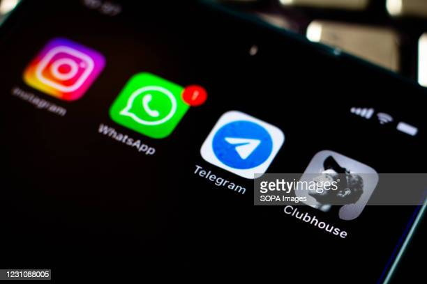 In this photo illustration, the Clubhouse, Instagram, Telegram and WhatsApp apps seen displayed on a smartphone screen.