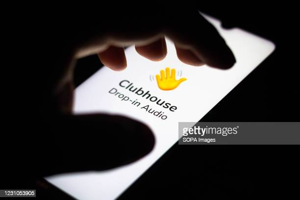 In this photo illustration the Clubhouse logo seen displayed on a smartphone screen.