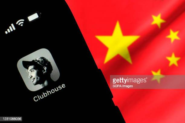 In this photo illustration, the Clubhouse logo seen displayed on a smartphone screen in front of the Chinese national flag.