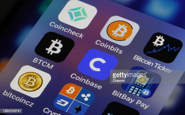 In this photo illustration, the Coinbase cryptocurrency exchange logo is seen on the screen of an iPhone on February 26, 2021 in Paris, France....