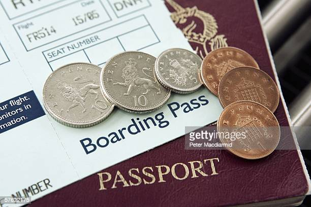 In this photo illustration the coins to the value of 28 pence are shown with a boarding pass and passport on May 15 2006 in London Low cost airlines...