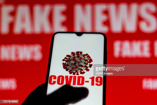 In this photo illustration the Covid19 virus displayed on a smartphone screen