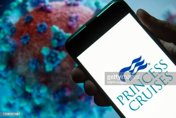 In this photo illustration the cruise line company Princess Cruises logo seen displayed on a smartphone with a computer model of the COVID-19...