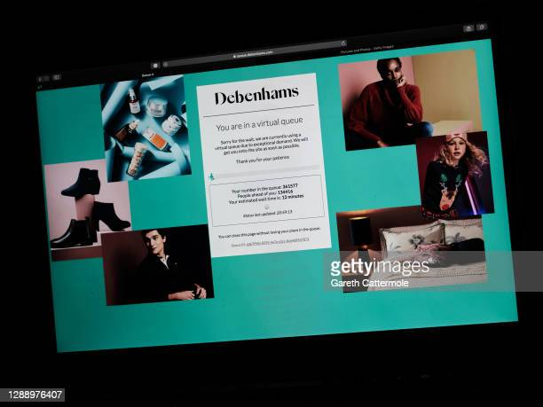 In this photo illustration the Debenhams website shows customers in a queuing system for access on December 1, 2020 in Essex, England. Debenhams...
