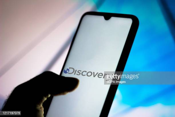 In this photo illustration the Discovery Communications logo seen displayed on a smartphone.