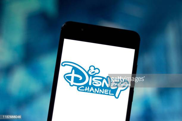 In this photo illustration the Disney Channel logo is seen displayed on a smartphone.