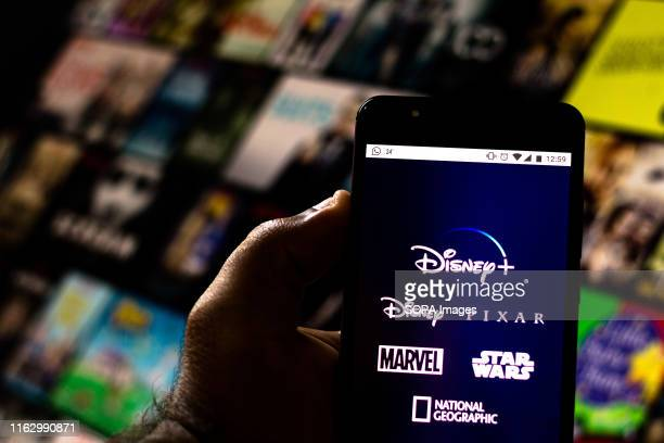 In this photo illustration the Disney+ logo is seen displayed on a smartphone.