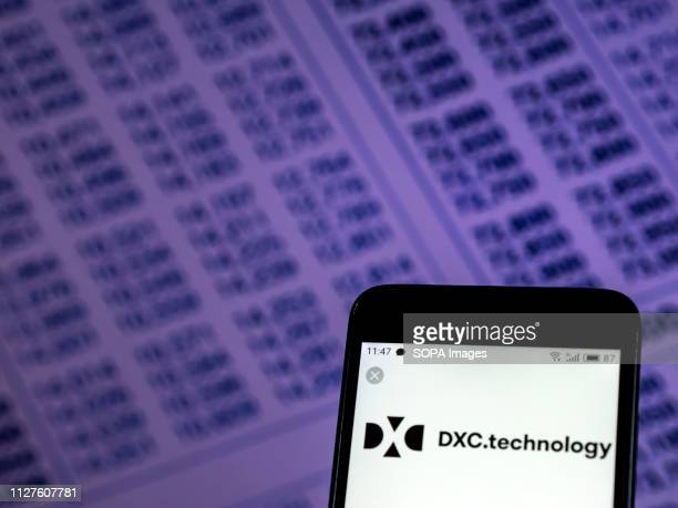In this photo illustration the DXC Technology Company logo seen displayed on a smartphone