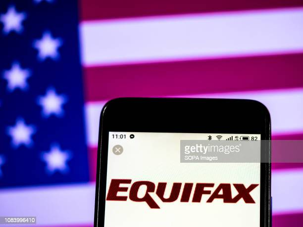In this photo illustration the Equifax Consumer reporting agency company logo seen displayed on a smartphone