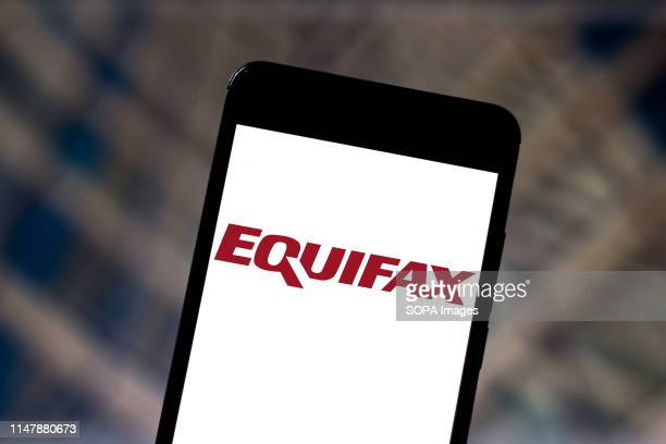 In this photo illustration the Equifax logo is seen displayed on a smartphone