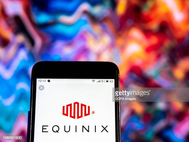 In this photo illustration the Equinix Internet services company logo seen displayed on a smartphone