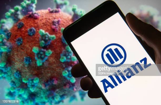 In this photo illustration the European financial services company Allianz logo seen displayed on a smartphone with a computer model of the COVID19...