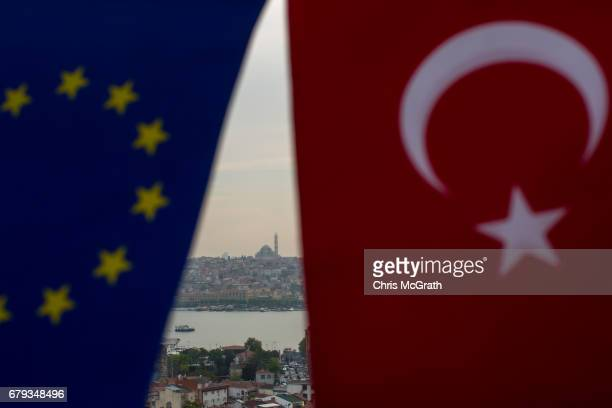 In this photo illustration the European Union and the Turkish National flag are seen together in front of the Istanbul skyline on May 05 2017 in...