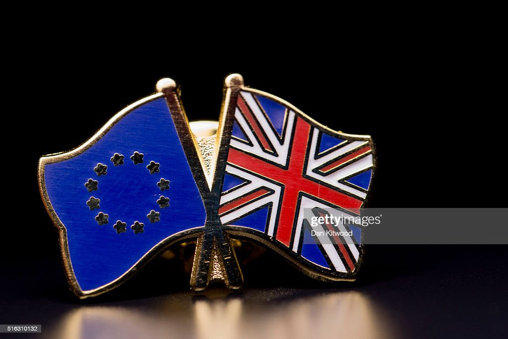 In this photo illustration, the European Union (L) and the Union flag are pictured on a pin badge on March 17, 2016 in London, United Kingdom. The United Kingdom will hold a referendum on June 23, 2016 to decide whether or not to remain a member of the European Union (EU), an economic and political partnership involving 28 European countries which allows members to trade together in a single market and free movement across its borders for citizens.