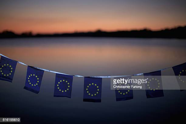 In this photo illustration the European Union flags on bunting adorn the British countryside on March 17 2016 in Knutsford United Kingdom The United...