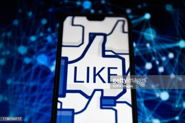In this photo illustration, the Facebook like logo is seen displayed on an Android mobile phone.