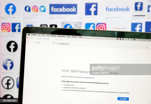 In this photo illustration, the Facebook logo is displayed next to a screen showing that the Facebook website is down on October 04, 2021 in San...