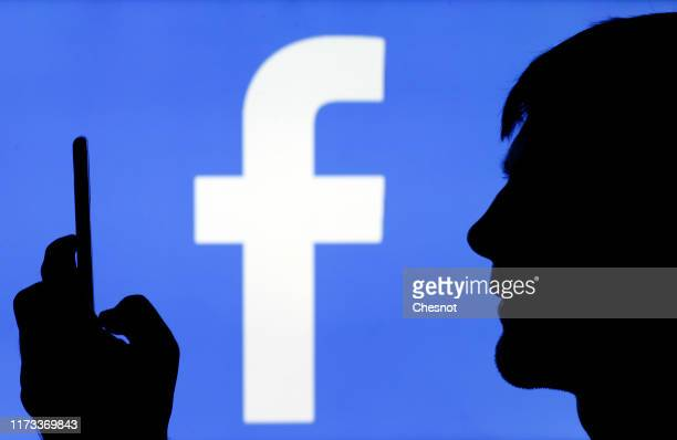 In this photo illustration, the Facebook logo is displayed on a TV screen on September 09, 2019 in Paris, France. Several US states have launched...