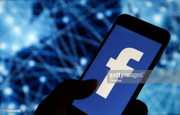 In this photo illustration the Facebook logo is displayed on the screen of a smartphone on September 09 2019 in Paris France Several US states have...