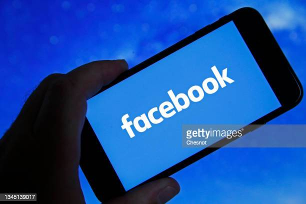 In this photo illustration, the Facebook logo is displayed on the screen of an iPhone on October 06, 2021 in Paris, France. Frances Haugen, a former...