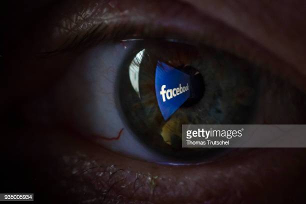 In this photo illustration the Facebook logo is reflected in an eye on March 20 2018 in Berlin Germany
